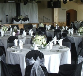 http://www.weddingflowersvancouver.com/apps/site/files/black_scuba_chair_covers.jpg