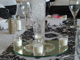 http://www.weddingflowersvancouver.com/apps/site/files/candle_votives_and_mirror_v1.jpg