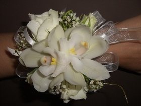 http://www.weddingflowersvancouver.com/apps/site/files/corsage_with_mini_orchid_and_spray_rose_v1.jpg