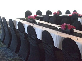 http://www.weddingflowersvancouver.com/apps/site/files/criss_cross_black_chair_cover_v1.jpg