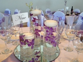 http://www.weddingflowersvancouver.com/apps/site/files/set_of_3_vases_with_orchids_and_candles.jpg