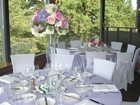 Tall wedding centerpiece in lavender and pink